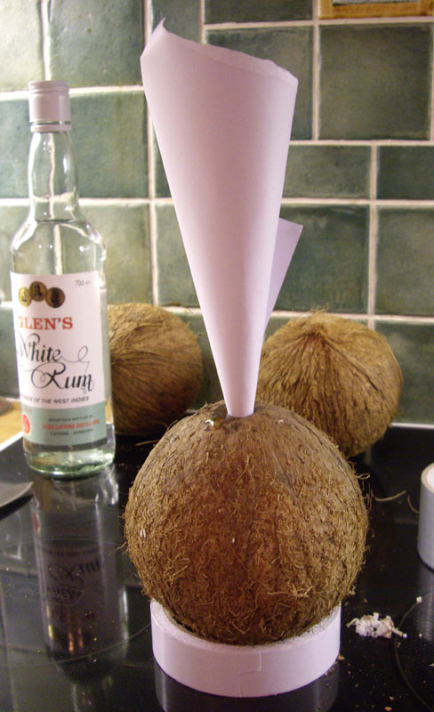 Get some kind of funnel so you can pour the rum inside the coconut. I would have used a plastic funnel if I had one, but I'm quite fond of the taste of paper so I decided to make one instead.